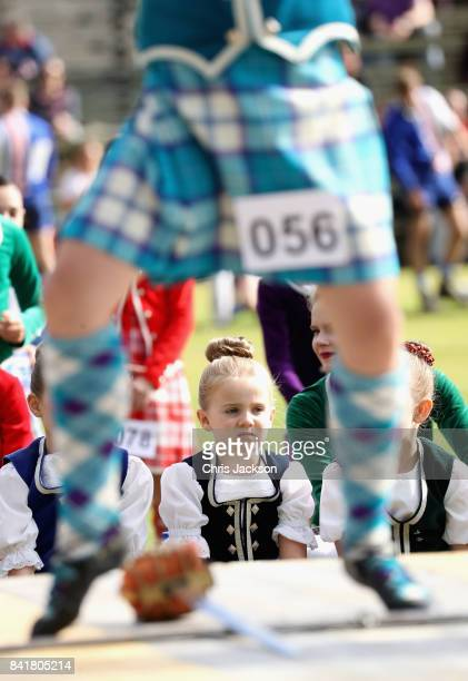 Young girls watch their fellow competitors during the highland dancing competition at the 2017 Braemar Gathering at The Princess Royal and Duke of...