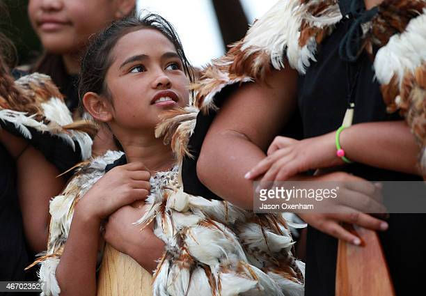 A young girls watches a Waka Ama crew perform on the beach to celebrate Waitangi Day on February 6 2014 in Paihia New Zealand The Waitangi Day...