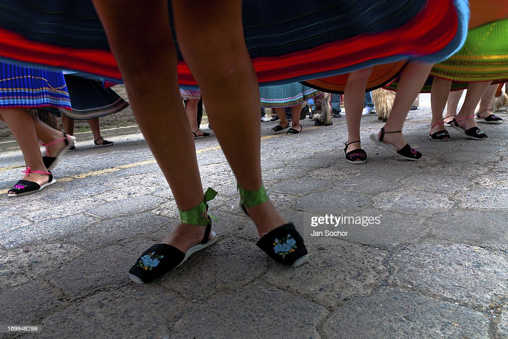 "Young girls, wearing colorful skirts, dance in a procession during the Inti Raymi celebration on 26 June 2010 in the village of Olmedo, Ecuador. Inti Raymi, ""Festival of the Sun"" in Quechua language, is an ancient spiritual ceremony held in the Indian regions of the Andes, mainly in Ecuador and Peru. The lively celebration, set by the winter solstice, goes on for various days. The highland Indians, wearing beautiful costumes, dance, drink and sing with no rest. Colorful processions in honor of the God Inti (Sun) pass through the mountain villages giving thanks for the harvest and expressing their deep relation to the Mother Earth (Pachamama)."