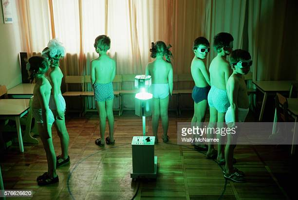 Young girls wearing undershorts and protective glasses undergo light deprivation treatment at their school in Stavropol USSR Strong fullspectrum...