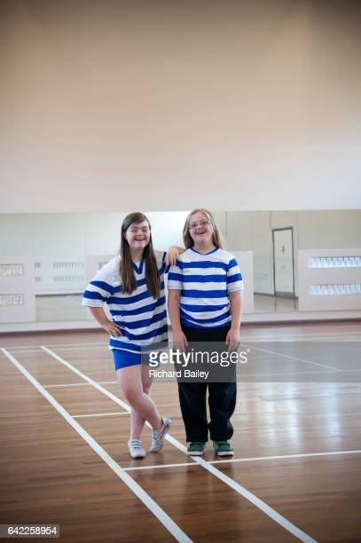 young girls who have down syndrome at football club. - learning disability stock pictures, royalty-free photos & images