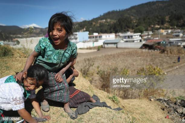 Young girls who's father works as as immigrant laborer in the US play in Cajola on February 11 2017 in the western highlands of Guatemala Women are...
