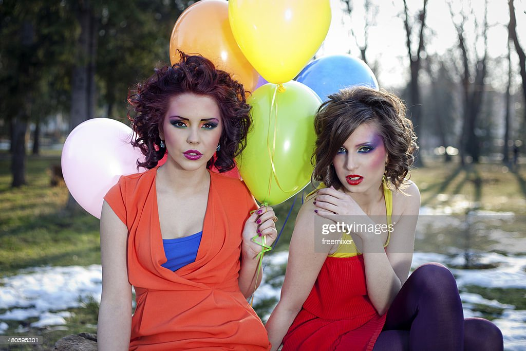 Young girls with a balloons in park : Stock Photo