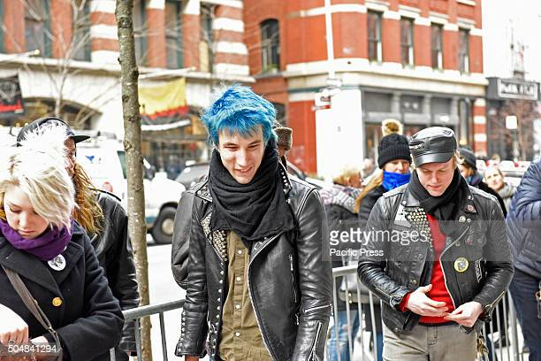 Young glam fans pass by Hundreds of New Yorkers filed quietly in front of singer David Bowie's SoHo home on Lafayette Street to pay their respects to...