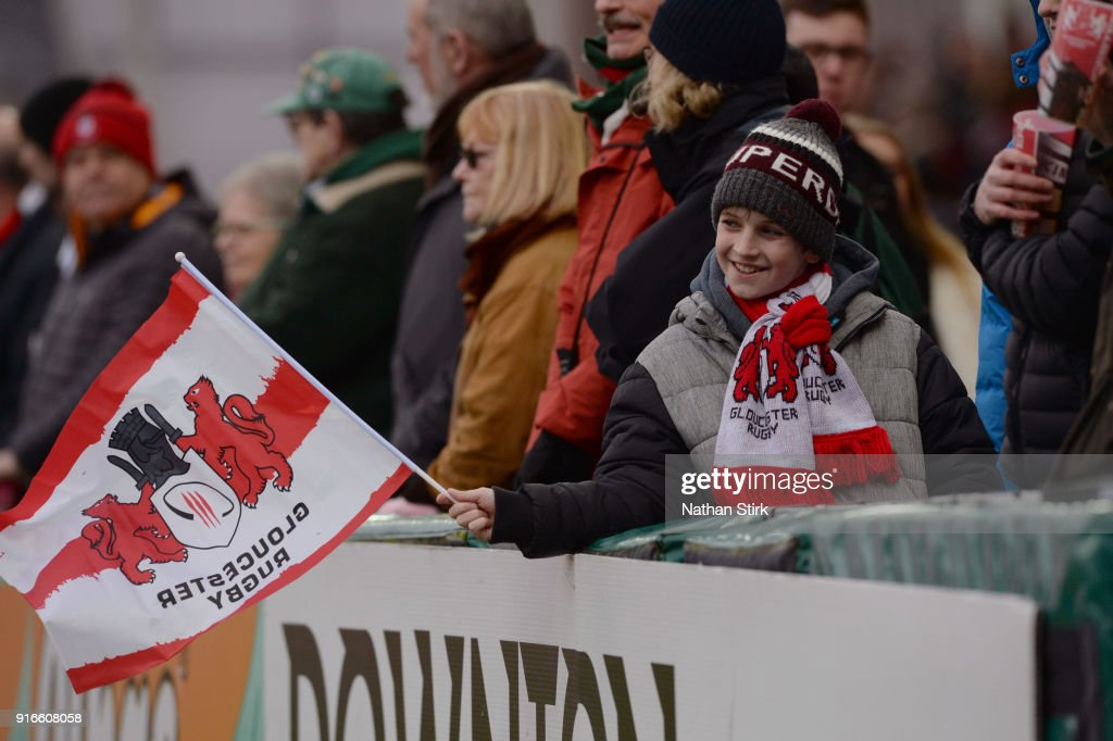 A young Gloucester fan waves a flag during the Aviva Premiership match between Gloucester Rugby and Leicester Tigers at Kingsholm Stadium on February 10, 2018 in Gloucester, England.