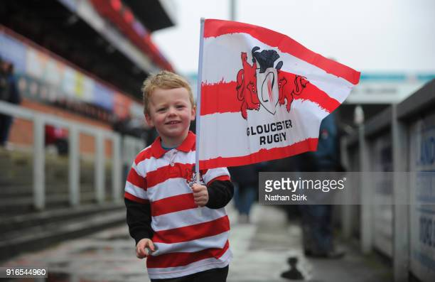 A young Gloucester Rugby fan waves a flag during the Aviva Premiership match between Gloucester Rugby and Leicester Tigers at Kingsholm Stadium on...