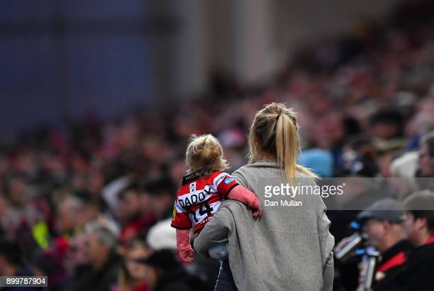 A young Gloucester supporter makes her way back to her seat during the Aviva Premiership match between Gloucester Rugby and Sale Sharks Sharks at...