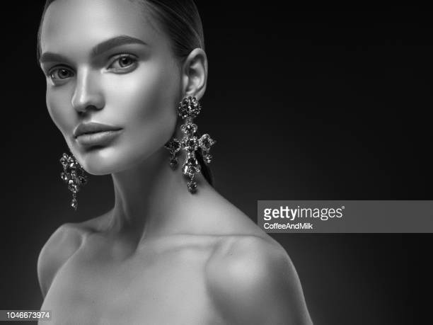 young gorgeous girl in evening gown and delicate make-up - jewelled stock pictures, royalty-free photos & images
