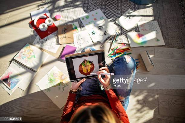 young graphic designer working from home - graphic designer stock pictures, royalty-free photos & images