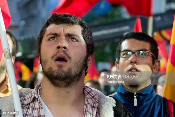 Young Greek Communist Party supporters with red flags shout slogans of support and solidarity during the major political rally for the coming...