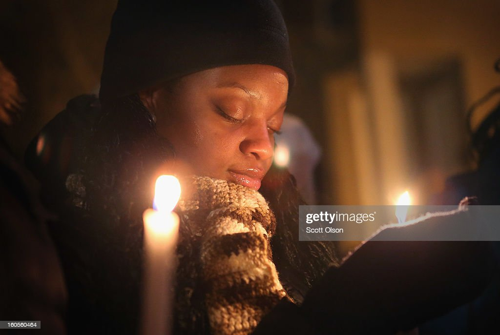 A young gril, along with friends and fellow students, participates in a candlelight vigil at Harsh Park in memory of Hadiya Pendleton on February 2, 2013 in Chicago, Illinois. Pendleton, a fifteen-year-old high school honor student, was shot and killed while hanging out with friends on a rainy afternoon under a shelter in the park on January 29. A $40,000 reward has been raised to help find her killer. Pendleton was the 44th homicide recorded in Chicago for 2013.