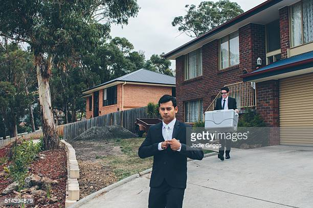 Young Groom leaving house on wedding day