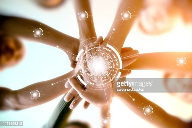 young group are join hands for working the job success , hands, symbolizing the hands to unity and line connection for teamwork ,success ,helps , business concept. - friendly match stockfoto's en -beelden
