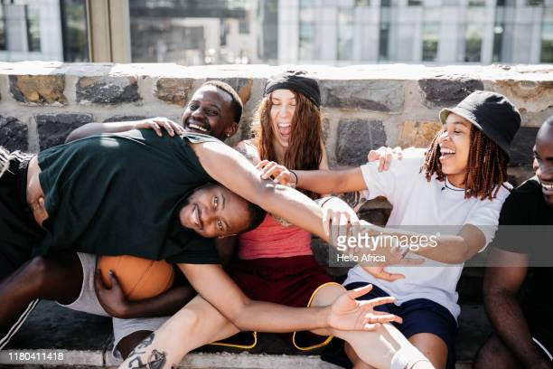 young group enjoying enjoying horsing around - gender role fotografías e imágenes de stock