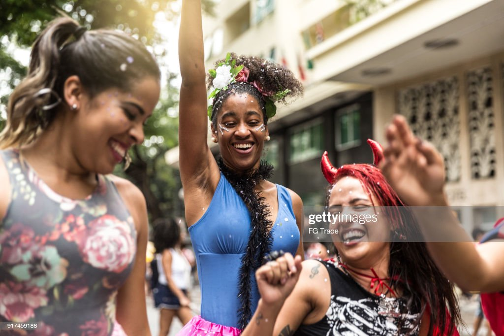 Young group having fun at the carnival street : Stock Photo