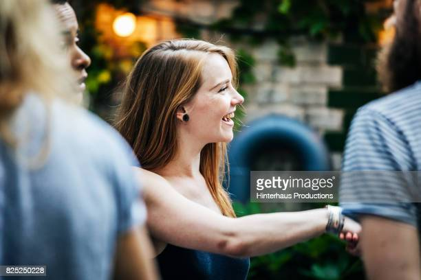 a young group of friends meeting up for a barbecue - community spirit stock pictures, royalty-free photos & images
