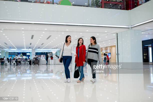 Young group of friends shopping together in the city