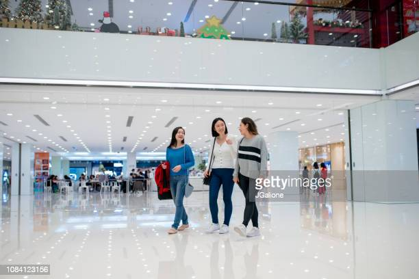 young group of friends shopping together in the city - fashion hong kong stock photos and pictures