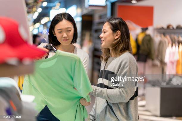 Young group of friends shopping together