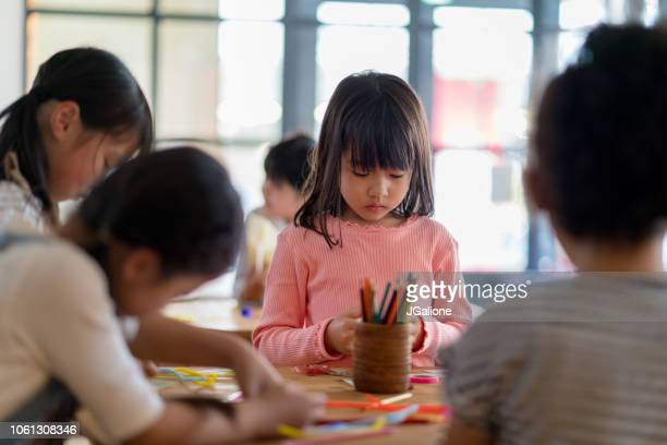 young group of students in an arts and crafts class - preschool age stock pictures, royalty-free photos & images