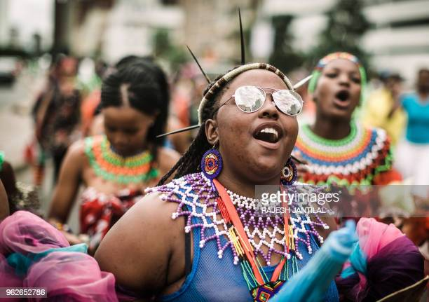 Young groups of maidens dressed in traditional attire take part on May 26 2018 in a street carnival festival in Durban celebrating Africa Month a...