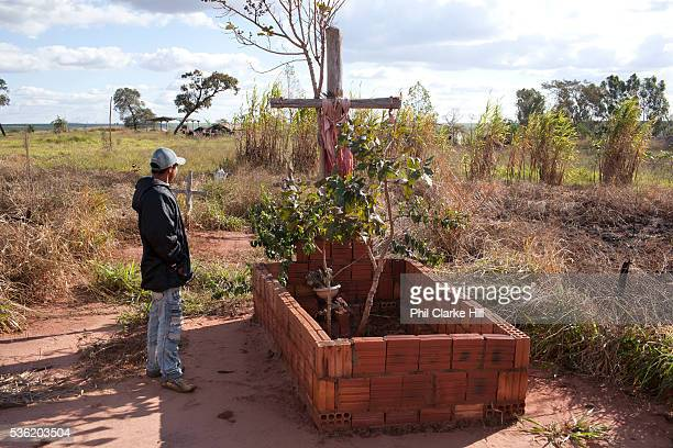 Young Guarani man looking at the grave of village tribe leader Marcus Veron, who was alleged murdered by neighbouring farmers over land conflicts....