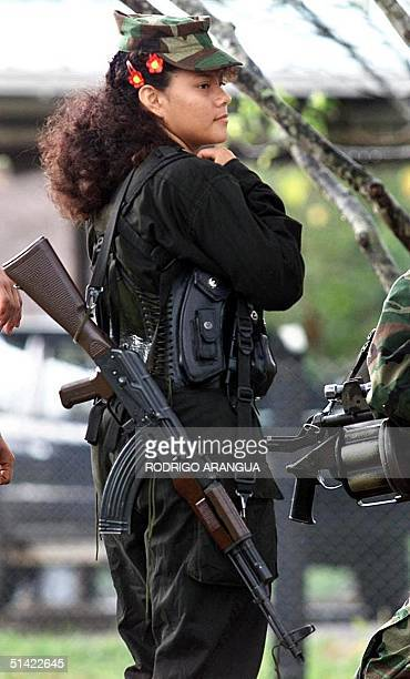 A young guerrilla of the Revolutionary Armed Forces of Colombia guards the arrival of the international delegates to Los Pozos Colombia 08 March 2001...