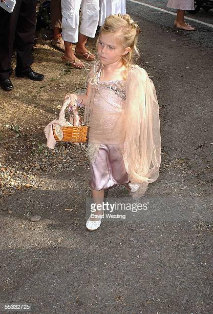 A young guest arrives for the wedding of model Jodie Kidd and internet tychoon Aidan Butler at St Peter's Church on September 10 2005 in Twineham...