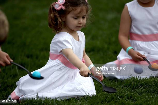 A young guest rolls her Easter Egg during the 139th Easter Egg Roll on the South Lawn of the White House April 17 2017 in Washington DC The White...