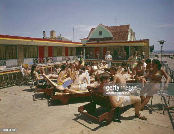 Young guests of the Tropicana Motel sunbath and socialize on the hotel's sundeck Atlantic City New Jersey 1960s