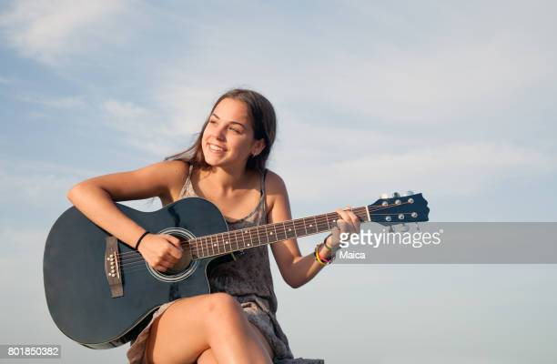 Young guitar player outdoors