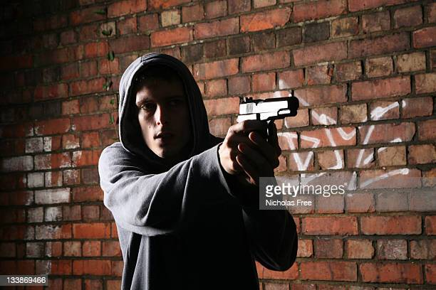 young gun criminal - armed robbery stock photos and pictures