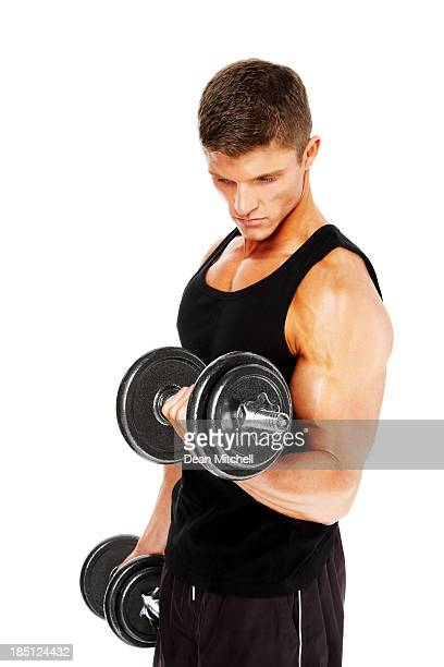 Young guy exercising with a dumbbell