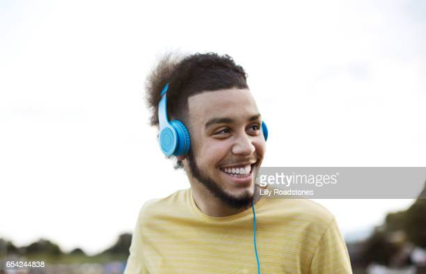 young guy smiling - young men stock pictures, royalty-free photos & images