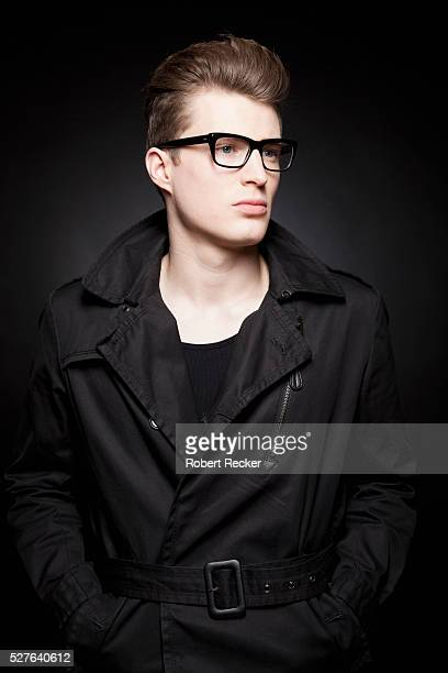 Young guy with glasses and black trenchcoat