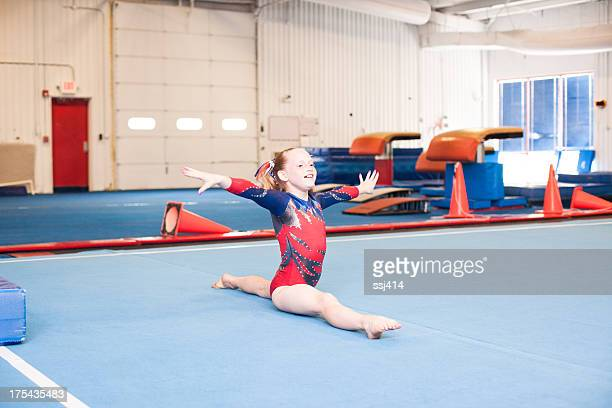 young gymnast doing floor routine - balance beam stock pictures, royalty-free photos & images
