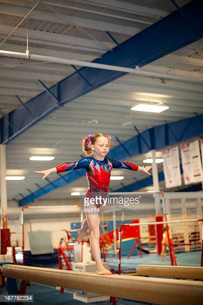 Young Gymnast Doing Routine on Balance Beam
