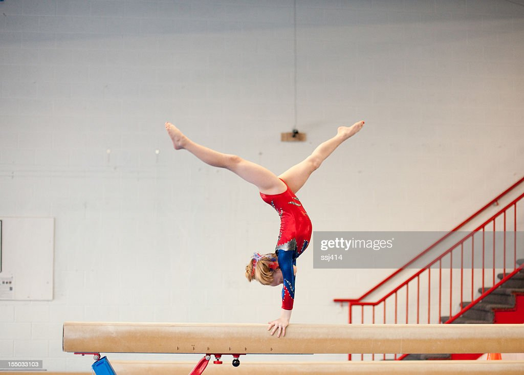 Young Gymnast in Handstand Split on Balance Beam : Stock Photo