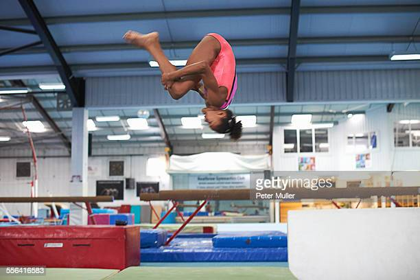 Young gymnast practising moves
