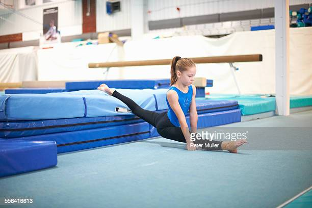 young gymnast practising moves - little girls doing gymnastics stock photos and pictures