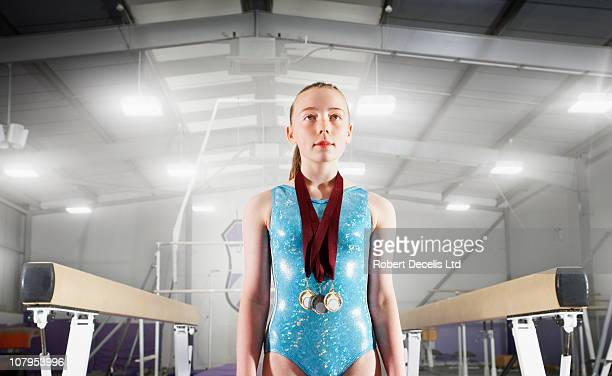Young gymnast with medals