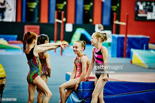 Young gymnasts laughing together during training