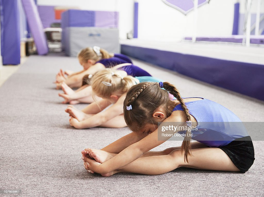 young gymnasts performing warming up routine : Stock Photo