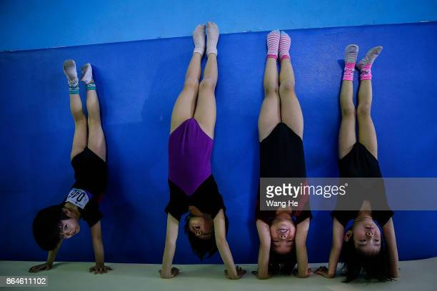 Young gymnasts practice during Yang Wei Cup China 2017 on October 21 2017 in Wuhan Hubei province China Named after former gymnast Yang Wei the Yang...