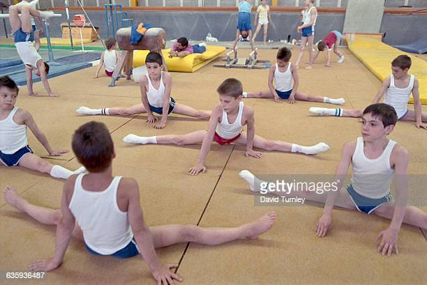 Young gymnasts stretch before practicing at a Hungarian statecontrolled central sports school The school trains students who were selected because...