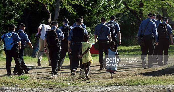 Young Haitian follow crew members of the Canadian Navy vessel HMCS Athabaskan as they walk into the city of Leogane on January 21, 2010 in Leogane,...