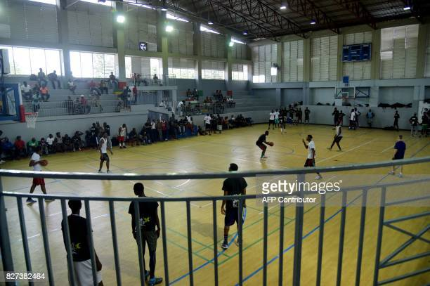 Young Haitian players take part in a basketball practice in a gymnasium in PortauPrince on May 19 2017 Young Haitian basketball players waiting for...