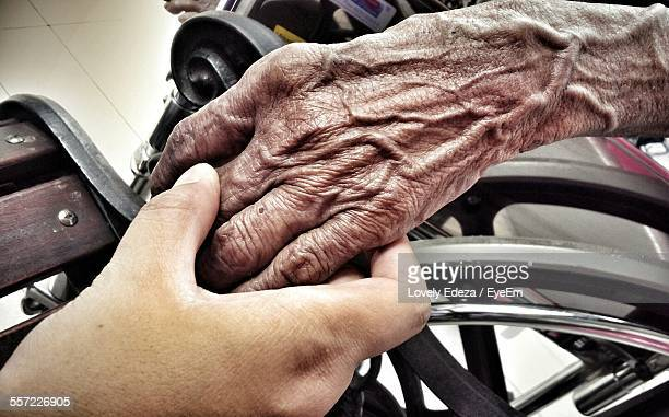 Young Hand Holding Old Wrinkled Hand
