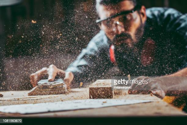 young handosme carpenter - furniture stock pictures, royalty-free photos & images