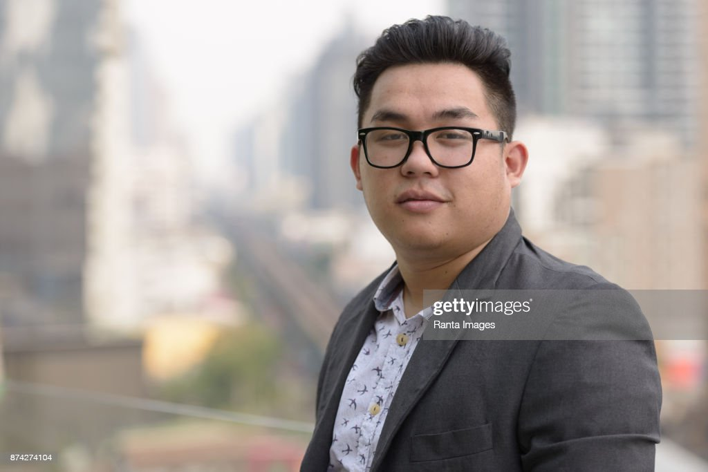 Young handsome Asian businessman enjoying life in the city of Bangkok, Thailand : Stock Photo